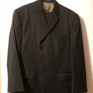 Brown Calvin Klein pinstriped suit